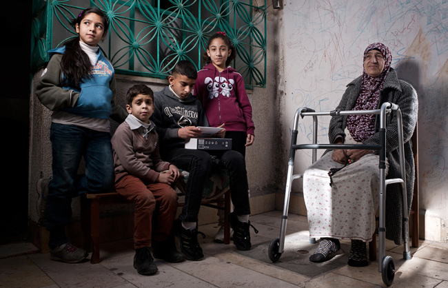In Palestine, several generations often live together under the same roof. This scene illustrates this practice of intergenerational living and presents an interesting family portrait. (Aida camp - Bethlehem - West Bank - Palestine - 2013)