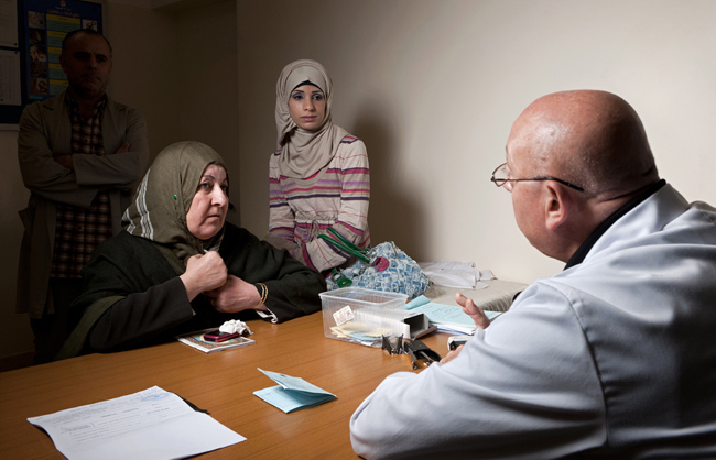Mother accompanied by her daughter and her husband seek medical advices at the health centre in Amman New Camp. (Amman New Camp - Amman - Jordan - 2013)