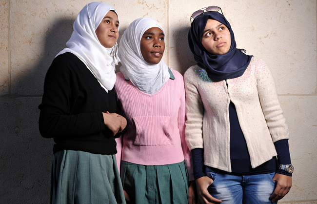 Three Palestinian Refugee girls at the Hussein Cultural Centre in Amman (Amman – Jordan - 2013)