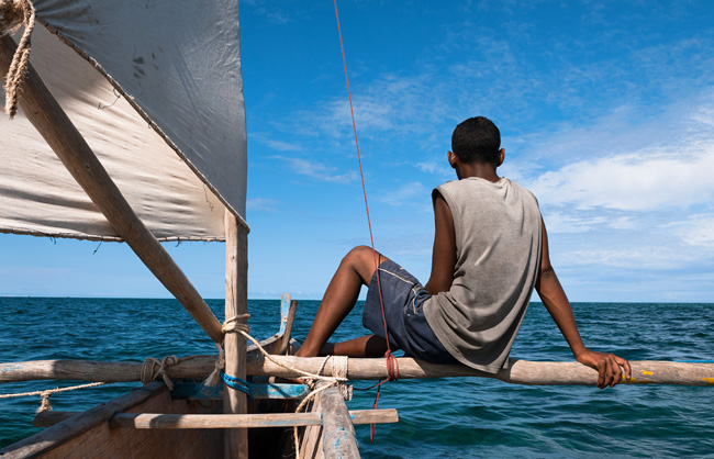 Fisherman on his traditional sailing boat in the Mozambique Channel
