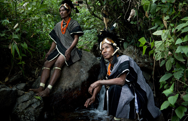 Heimi Naga warriors from the village of Niansao refreshing themselves at the river.