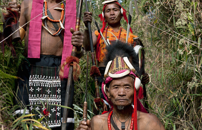 Makuri Naga warriors with their spears and their dao (traditional knife). The tattooed chest was traditionally only allowed to those who had taken part in a raid. The human figure was added to those who had participated in the death and took the head of an enemy.