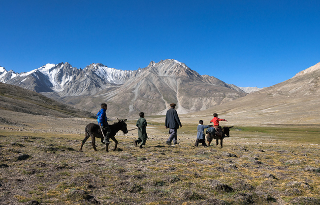 Father with his children going to check on the livestock. Big Pamir - Afhanistan - 2014